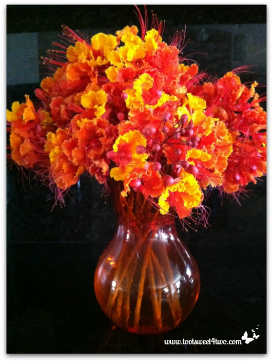 Mexican Bird of Paradise in an orange vase - Orange Crush