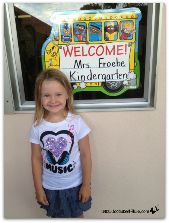Princess P posing outside her kindergarten classroom
