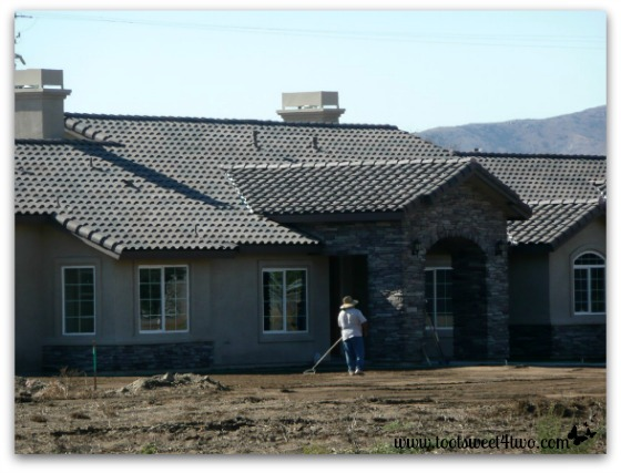 Another front view of the house and completed stone work.