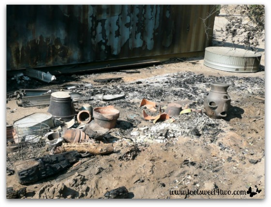 Fire damaged storage units and garden pots