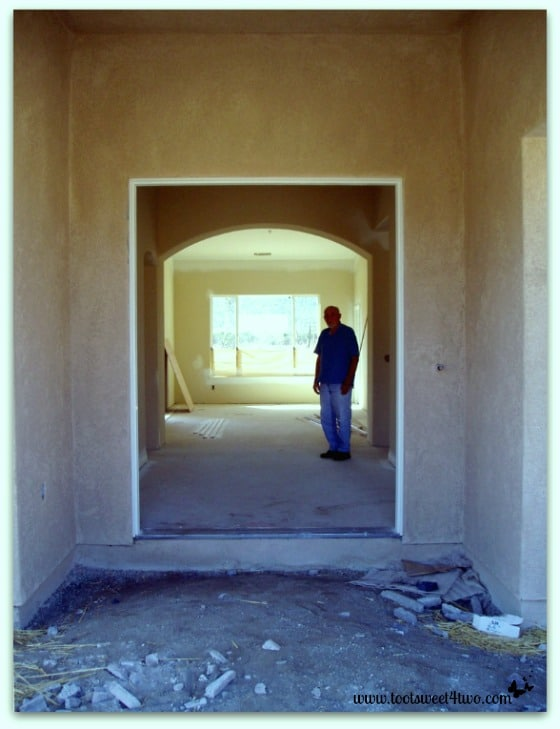 My father (the fabulous artist!) in the front entrance of our new house.