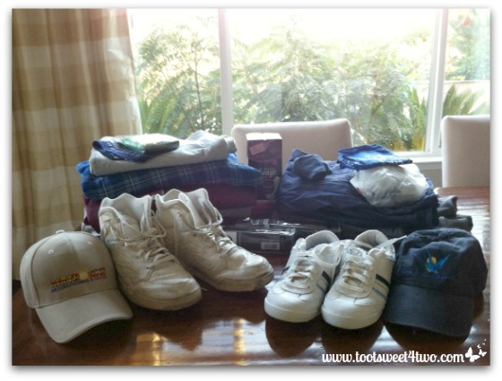 Old clothes and shoes gathered for emergency kit