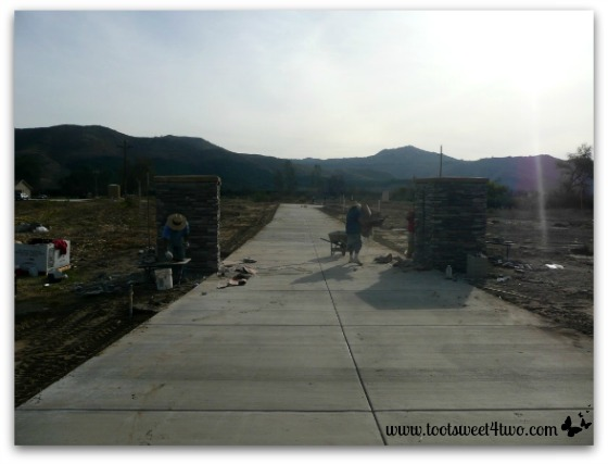 The crew installing the pillars that will support our front gate.