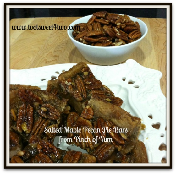A plate full of Salted Maple Pecan Pie Bars with a bowl of pecans