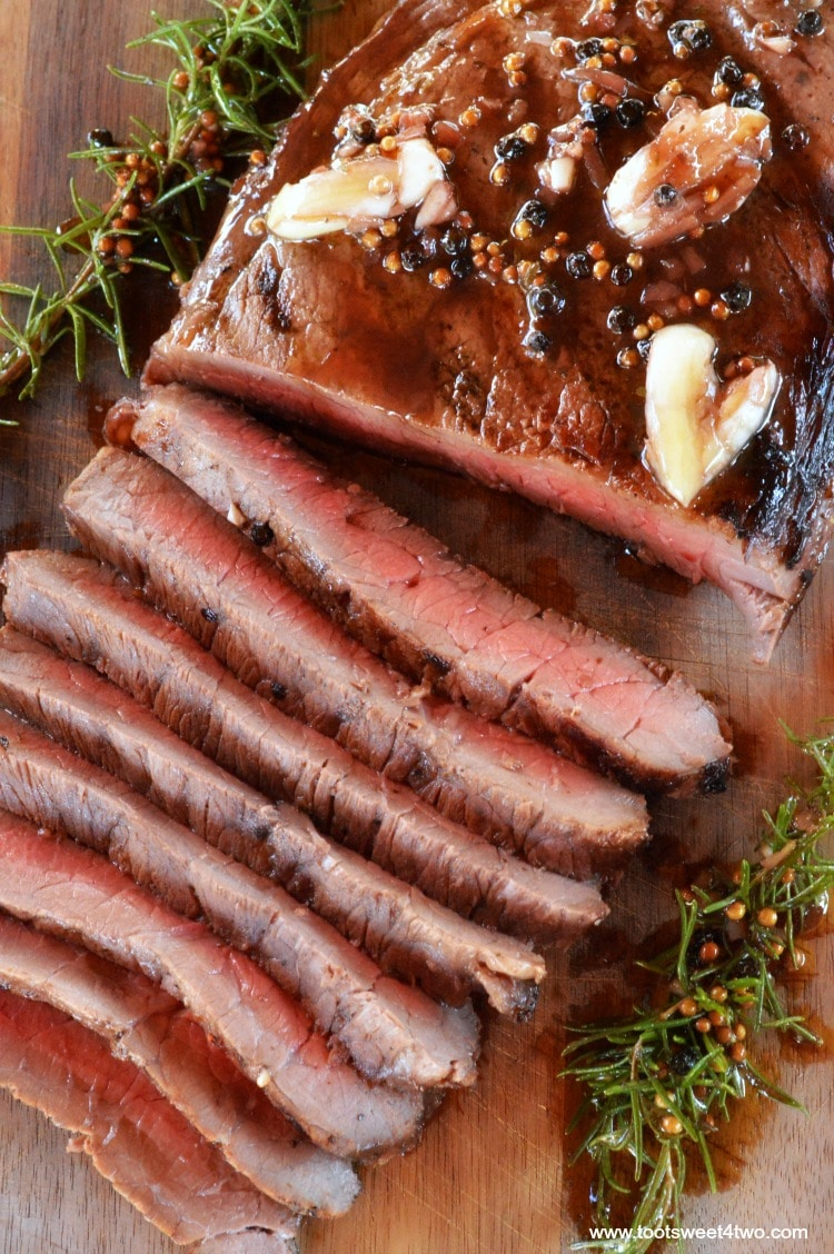 Want to make the perfect London broil? Then you need to do two things - marinate it for several hours and grill it! This simple and easy recipe for Grilled London Broil is not something you can make at the last minute. Because London Broil, aka flank steak, is a tougher cut of meat, the key to this flavorful, delicious, juicy and tender main course is marinating it for 4 to 6 hours. | www.tootsweet4two.com
