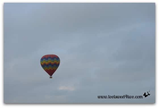Rainbow Hot Air Balloon high in the sky