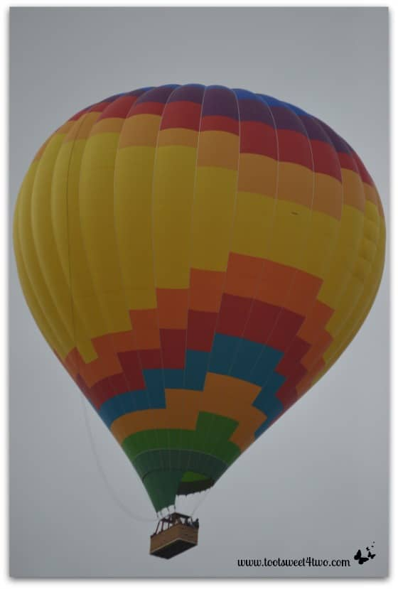 Yellow-centered Hot Air Balloon ascending