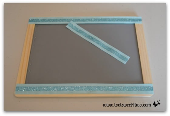 Glue ribbon to chalkboard