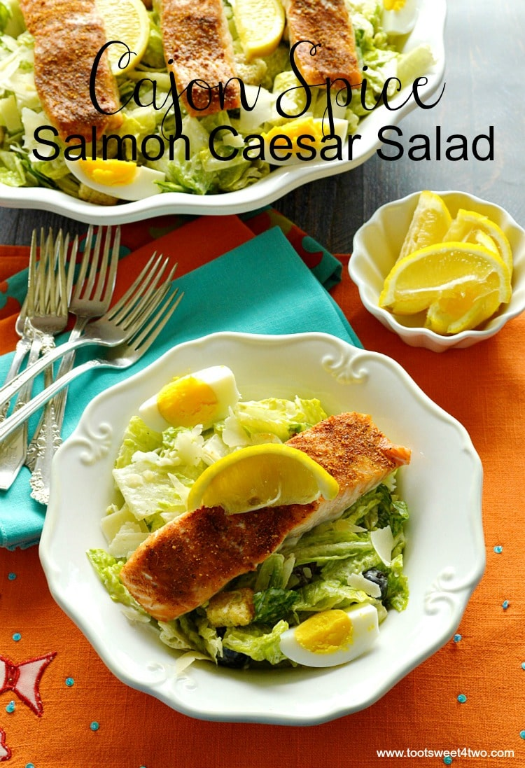 Cajun Spice Salmon Caesar Salad is the perfect recipe for an easy and healthy lunch, brunch or dinner on a busy day. Salmon fillets are slathered in Cajun spice and baked in the oven to perfection. Served on a bed of crisp romaine lettuce tossed with Caesar dressing, Cajun Spice Salmon Caesar Salad is a main dish meal that is so delicious you'll make it again and again! | www.tootsweet4two.com.