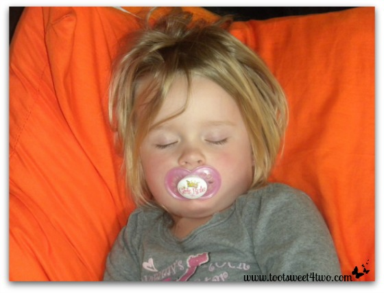 Little Princess P sleeping on orange pillow