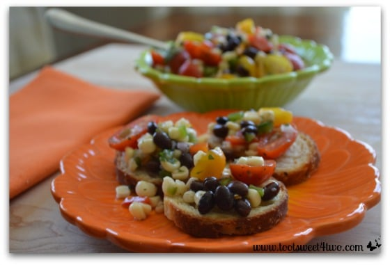 Mexican Corn Salad Bruschetta on orange plate