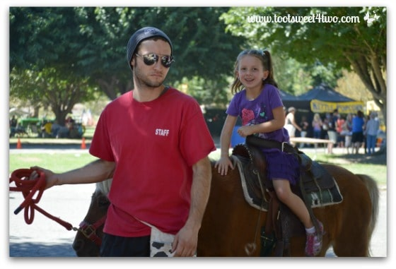 Princess Sweet Child and her pony ride guide