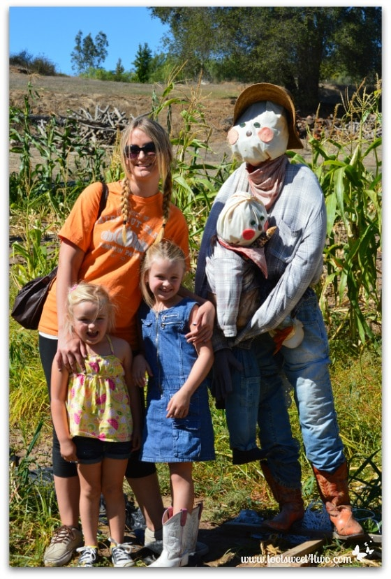 The girls and scarecrow father and scarecrow child