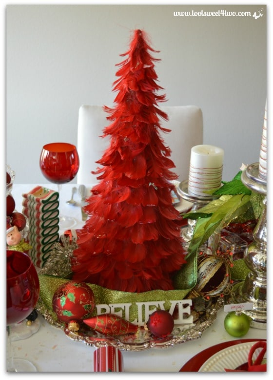 Red feather tree on a silver platter