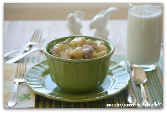 Creamed Potatoes with Ham and Petite Peas and a glass of milk