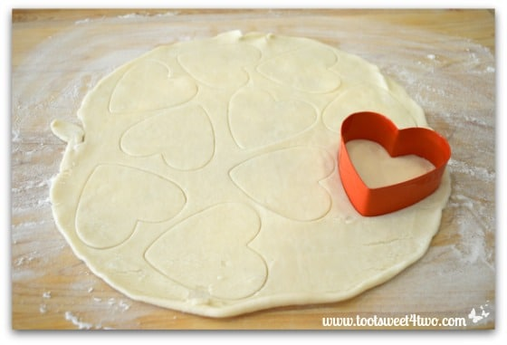 Pie crust dough and heart-shaped cookie cutter