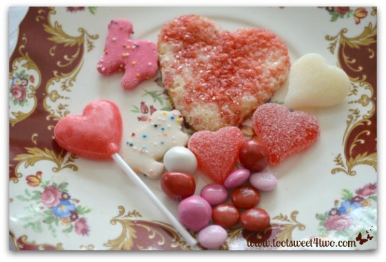 Valentine candy and cookies on an English dessert plate