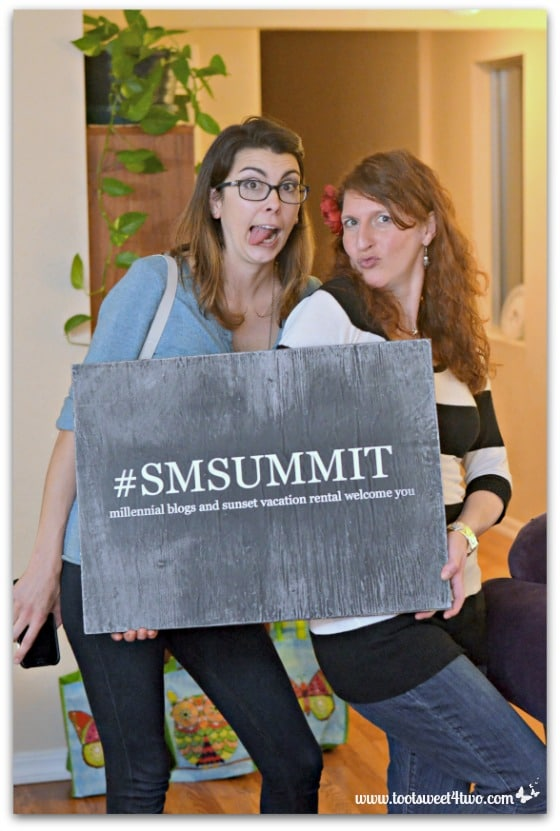 Chelsea and Amy holding the SMSummit sign - 17 girls and a baby