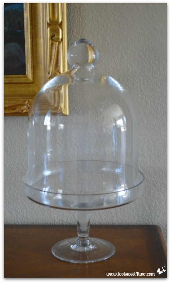 The empty glass cloche by my front door - 42 Things in Your Foyer