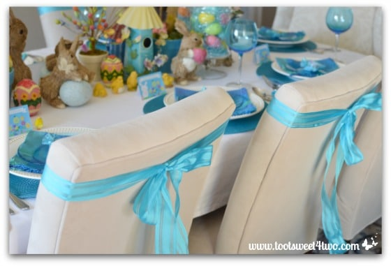 Blue ribbon on chairs - Decorating the Table for an Easter Celebration