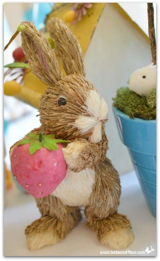 Straw Bunny holding strawberry - Decorating the Table for an Easter Celebration