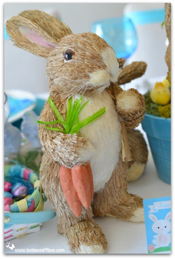 Straw Bunny with carrots and shovel - Decorating the Table for an Easter Celebration