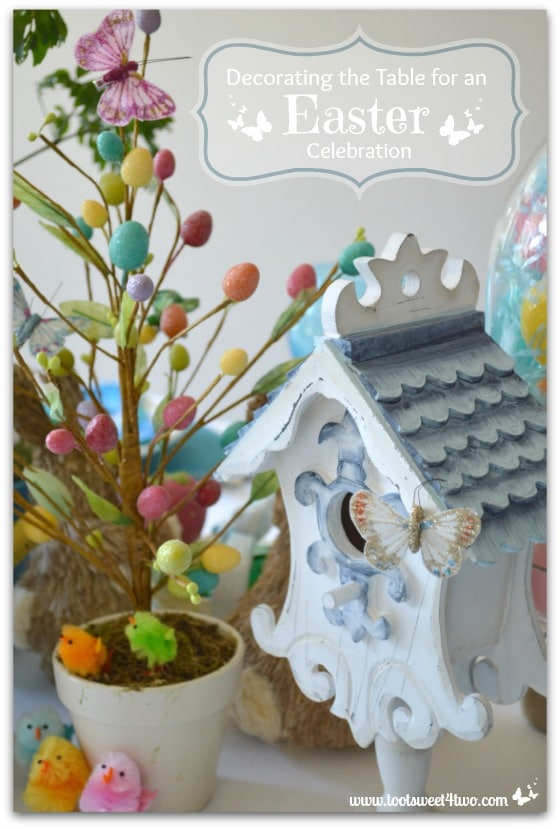 White birdhouse and egg tree - Decorating the Table for an Easter Celebration