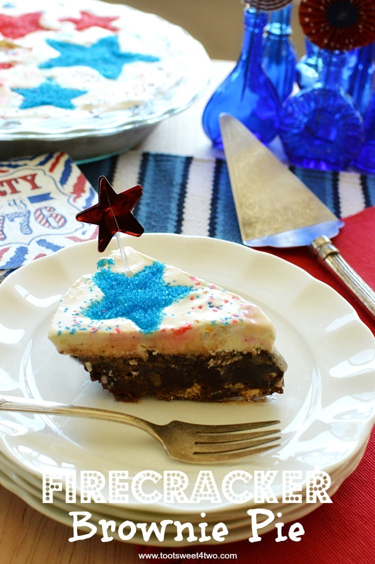 Firecracker Brownie Pie - a fun and festive 4th of July brownie recipe made with store-bough chocolate fudge brownie mix. Jarred hot fudge topping, vanilla ice cream and a surprise ingredient make this easy Independence Day dessert worthy of any Patriotic party celebration! Add sparkly red and blue stars by using various size star-shaped cookie cutters! | www.tootsweet4two.com