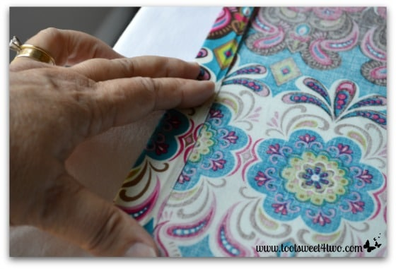 How To Make An Easy No Sew Table Runner   Pic 6   Hold Fabric In