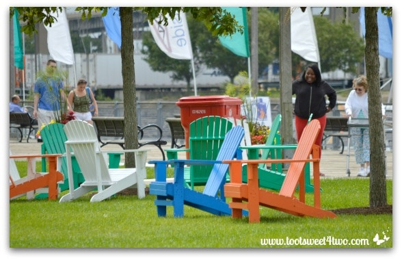 Adirondack chairs and visitors at Canalside