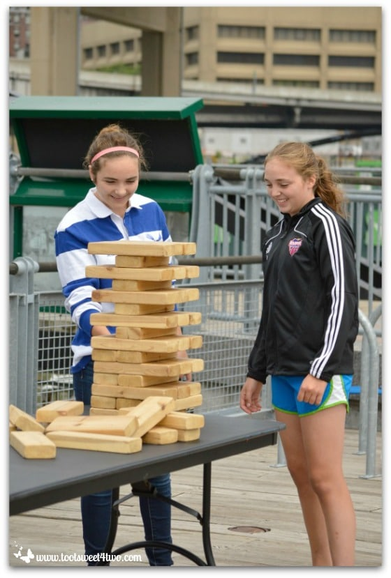 Molly and Bizzy at Canalside playing board game