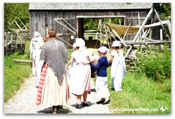 Pioneer women and girls at Pioneer Farmstead Barn at Genesee Country Village