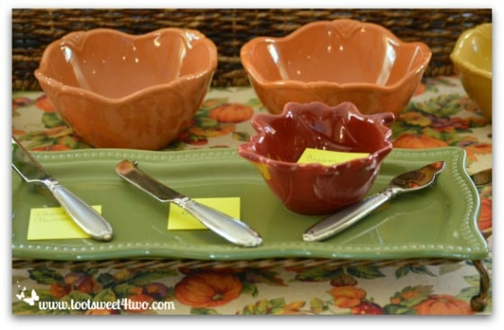 Autumn colored appetizer platter and dishes on serving table