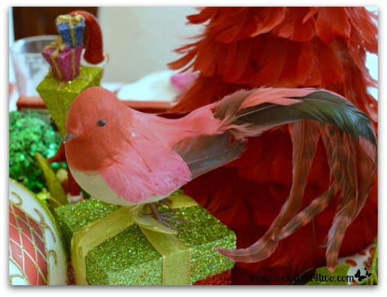 Red feathered bird on Christmas table