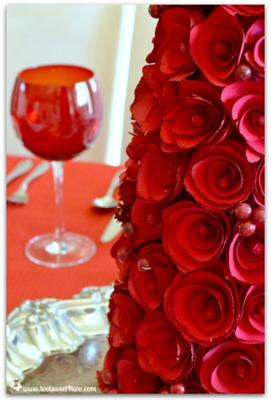 Close-up of red rose-covered tree centerpiece