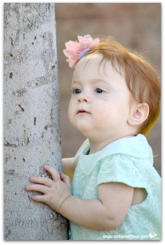 Princess Sweet Cheeks holding tree