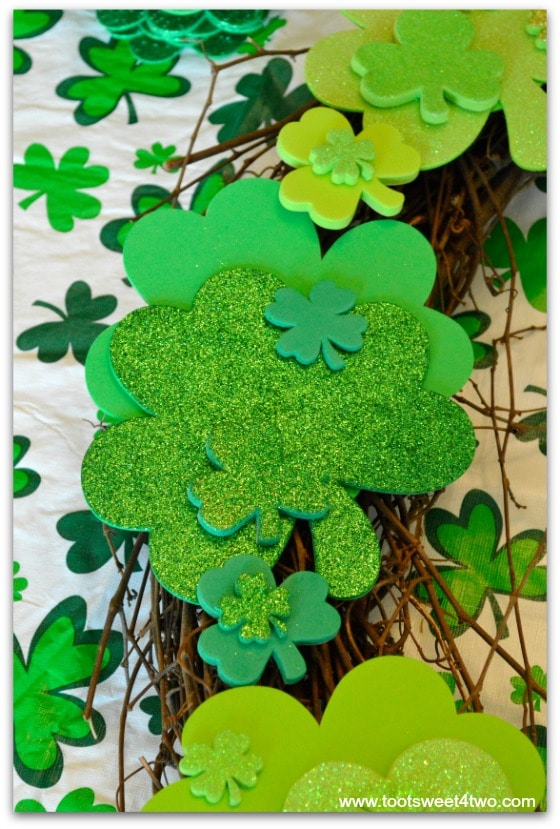 Close-up of shamrocks placed on grapevine wreath