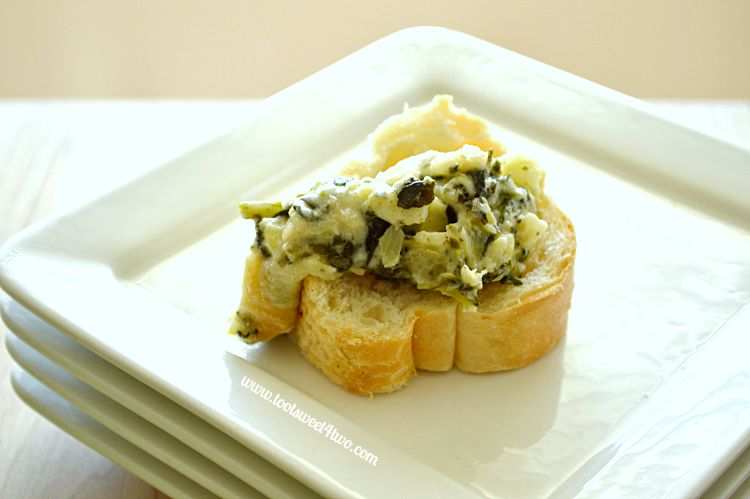 Cheesy Spinach and Artichoke Dip on baguette slice