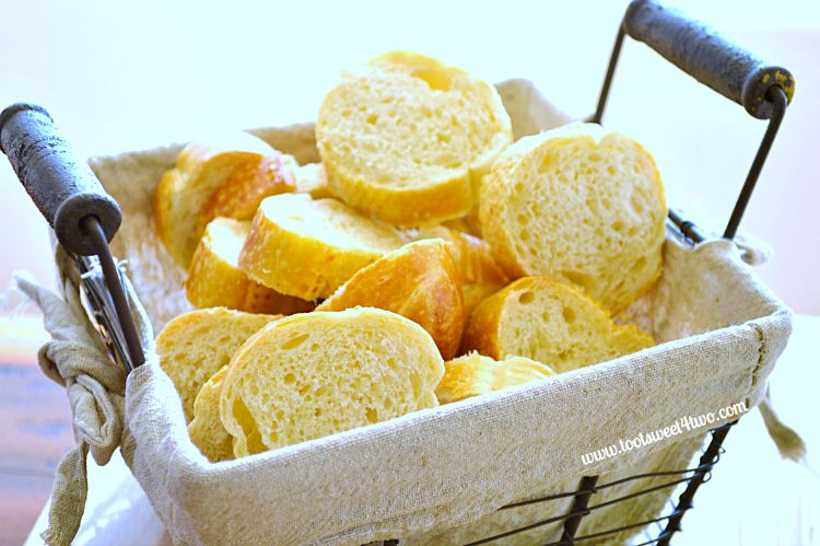 French baguette slices in a wire basket