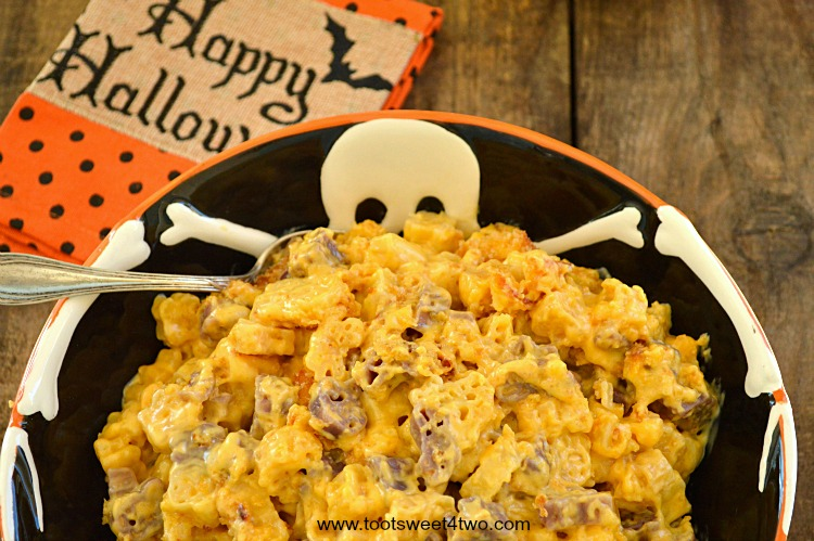 Cheesy Brown Butter Halloween Mac & Cheese in Skeleton serving bowl close-up