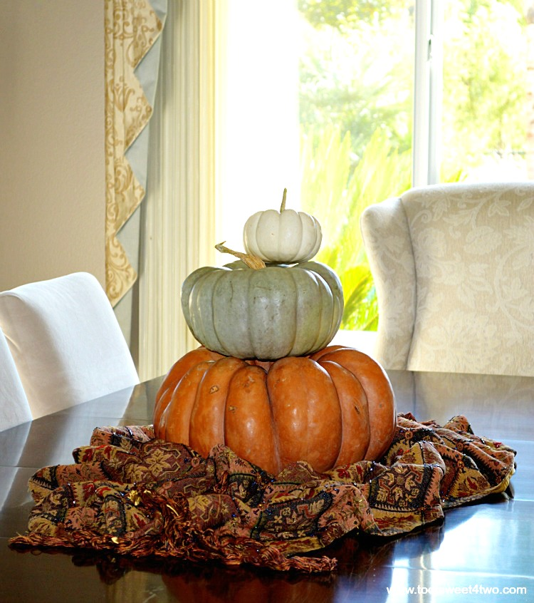 Cinderella pumpkin, Jarrahdale pumpkin, Baby Boo pumpkin stacked on dining room table