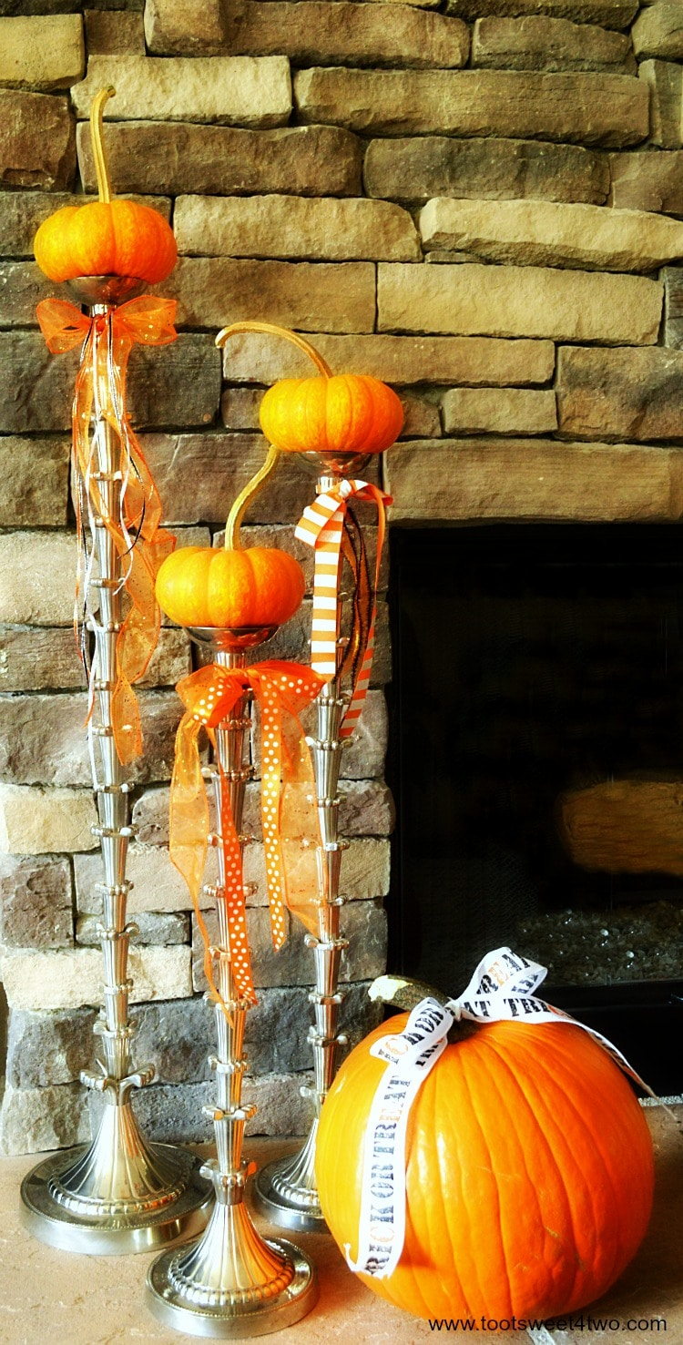 Jack-Be-Little pumpkins and Howden pumpkin on the fireplace hearth