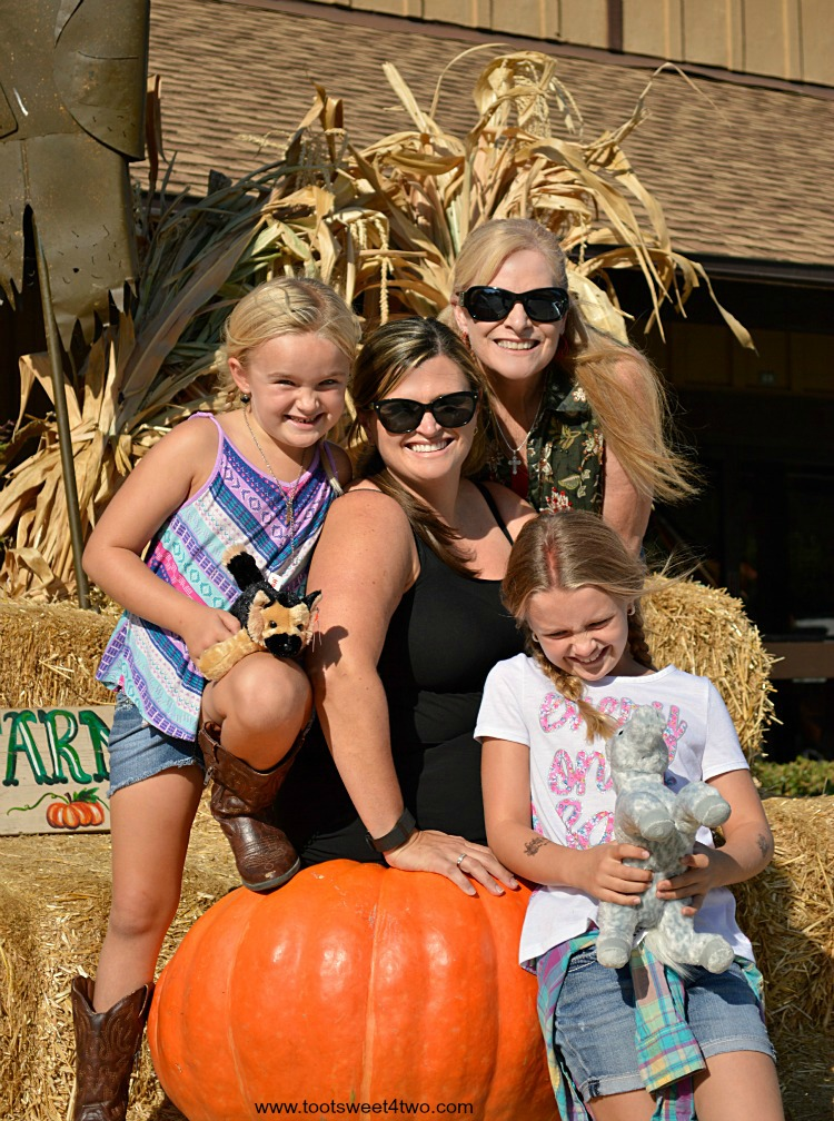 My family stacked on Big Mac pumpkin at Bates Nut Farm