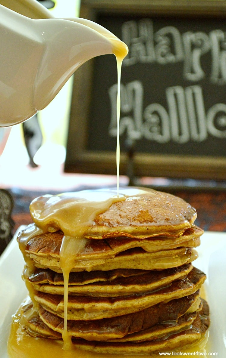 Pumpkin Pancakes with pouring Maple Butter Glaze
