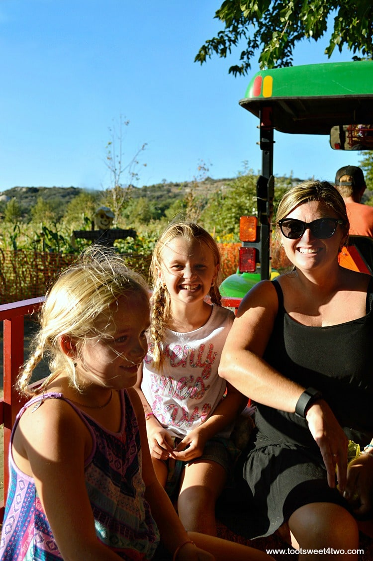 Tiffany and the Princesses P on a hay ride at the pumpkin patch 2015