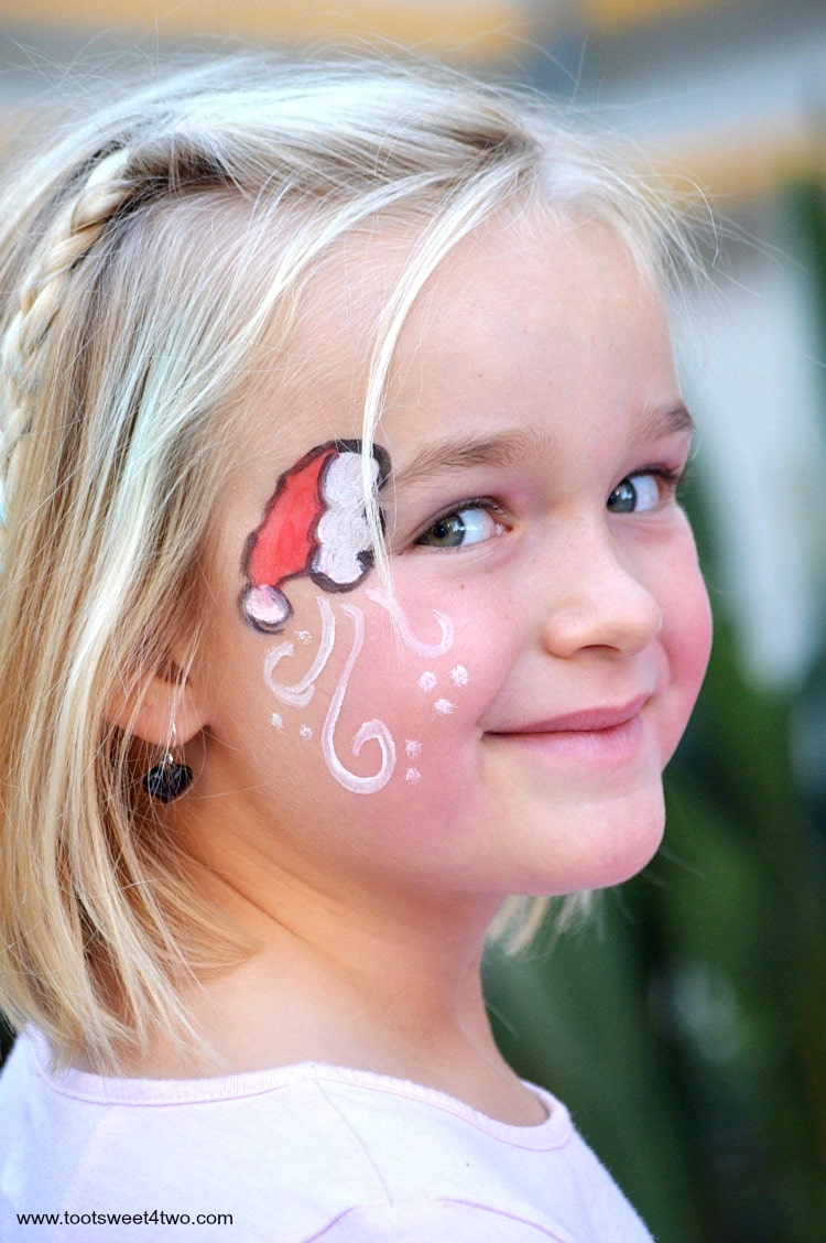 Princess Sweetie Pie with Santa hat face-painting