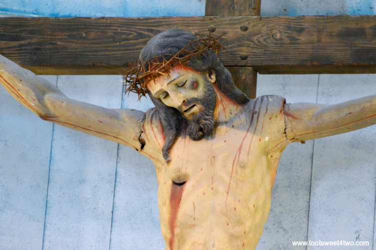 Altar statue of Jesus on the Cross inside Mission San Luis Rey Church