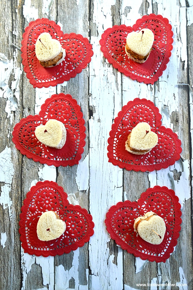 Mini Sweetheart Meatloaf Sandwiches on red heart paper doilies