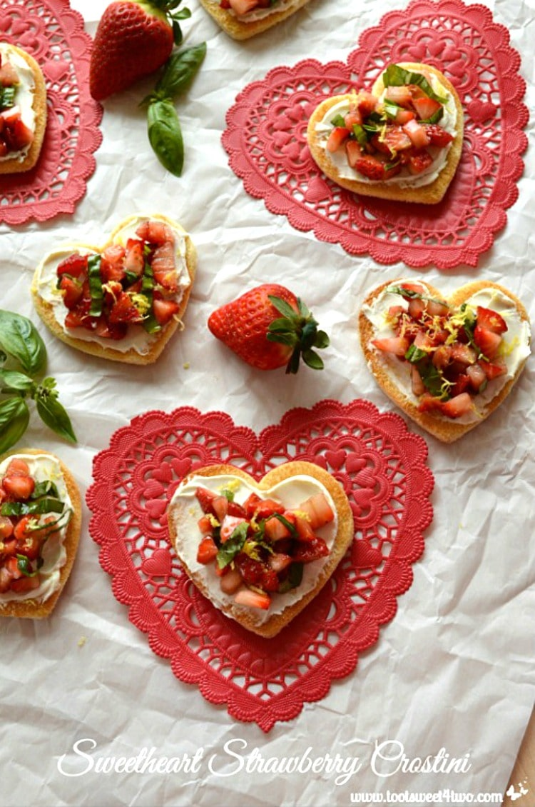 Sweetheart Strawberry Crostini on red heart-shaped paper doilies