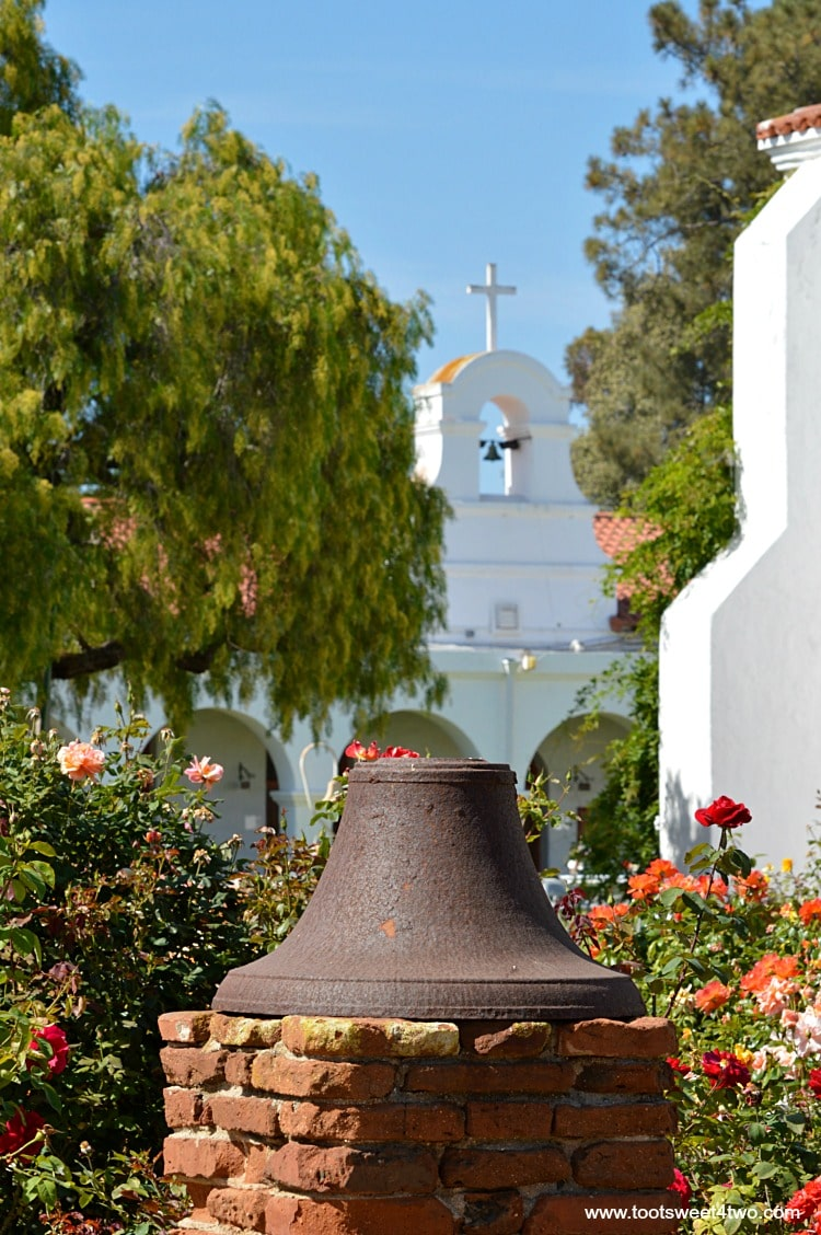 Iron bell in the gardens at Mission San Luis Rey Welcome Center